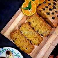 Whole Wheat Orange Cake / Moist Orange Cake / Eggless Jaggery Orange Cake